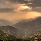 Green mountains over red sky by NatureBeauty