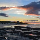 Bamburgh Castle At Sunset. by Dave Staton