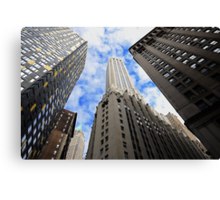 Looking up a skyscraper office block in New York City Canvas Print