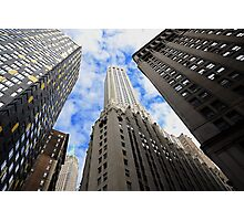 Looking up a skyscraper office block in New York City Photographic Print