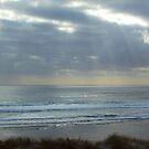 Sun peeping through the clouds - Mangawhai Surf Beach - New Zealand by amypie71