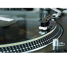 Turntable playing vinyl record with music Photographic Print