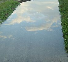 Clouds in The Sidewalk by Athenawp