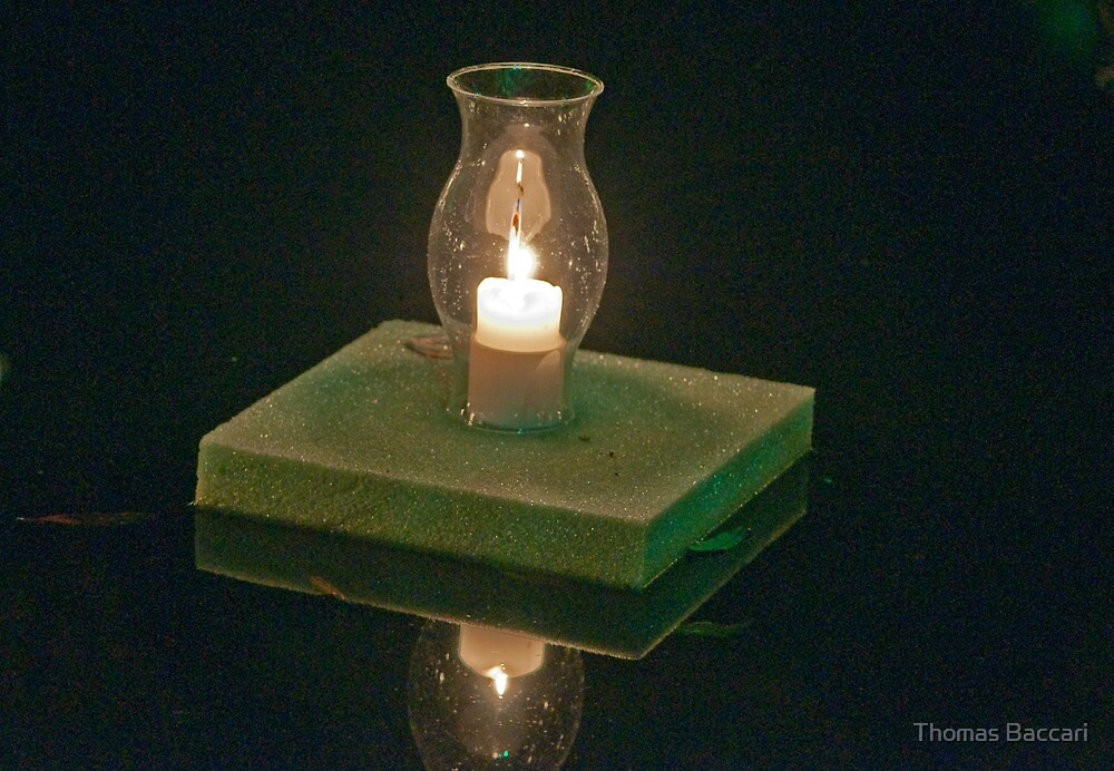 Floating Candle by TJ Baccari Photography