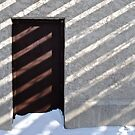 door, shadow and snow  by richard  webb
