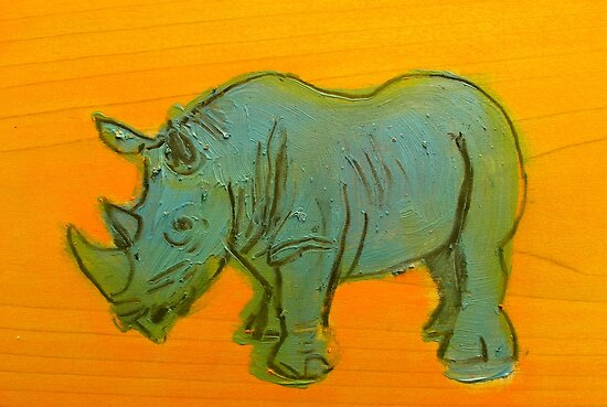 rhino toy on orange background by donnamalone