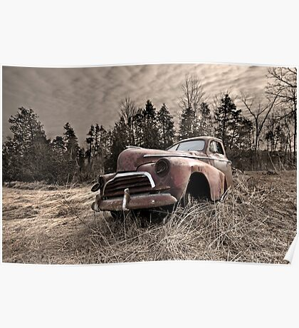 Abandoned rusted old truck in field Poster