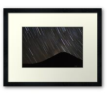 The stars wheel over Mt. Doom Framed Print