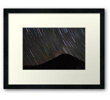 The stars wheel over Mt. Doom Framed Print