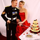 Beautiful Bride and Handsome Groom cutting cake by thermosoflask