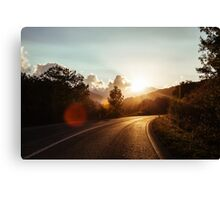 Road at sunset Canvas Print