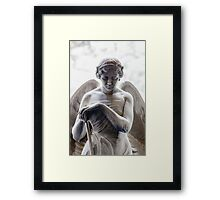 Leaning on a stick Framed Print
