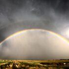 Storm Clouds Saskatchewan rainbow in prairie Canada by pictureguy