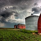 Storm Clouds Saskatchewan Red buildings granary storage by pictureguy