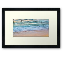Waves meets sand Framed Print