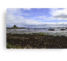 Lindisfarne Looking Across To The Castle Canvas Print