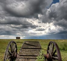 Old Prairie Wheel Cart Saskatchewan Canada field by pictureguy