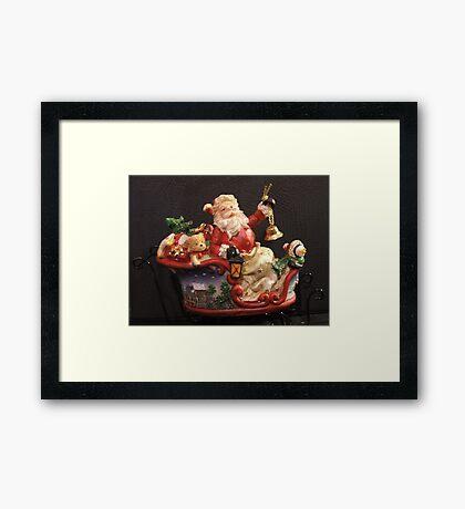 Santa on sleigh Framed Print