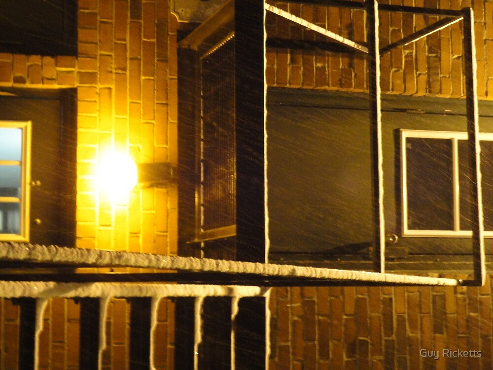 Wet Snow On A Black Metal Balcony by Guy Ricketts