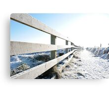 snow covered path on cliff edge fenced walk Canvas Print
