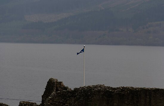 Scottish flag flying high over the remains of Urquhart Castle  by ashishagarwal74
