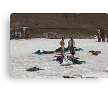 Locals with a pile of ice boots and snow jackets Canvas Print