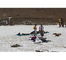 Locals with a pile of ice boots and snow jackets Photographic Print
