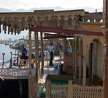Tourists at the front section of houseboats by ashishagarwal74