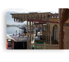 Tourists at the front section of houseboats Canvas Print