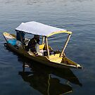 2 Kashmiri men on a small boat in the Dal Lake in Srinagar by ashishagarwal74
