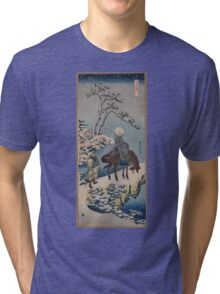 Two travelers one on horseback on a precipice or natural bridge during a snowstorm 001 Tri-blend T-Shirt