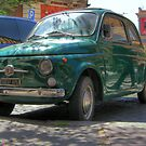 Green Fiat 500 in Rome, Italy by wildrain