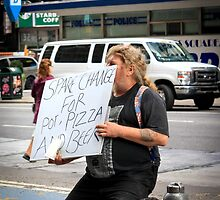 Spare Change at the NYPD by Mikell Herrick