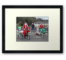 I thought Santa used Reindeers not bikes. Must lay off the whisky as I'm hallucinating. Framed Print