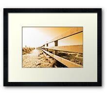 snow covered path on cliff fenced walk at sunset Framed Print