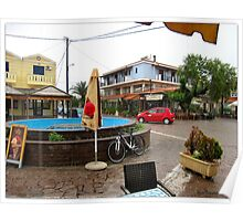 A little square on the island of Lesvos, in the rain. Poster