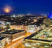 Moon rising over Hannover, Germany by Michael Abid