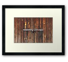 Old Wooden door locked with rusty padlock Framed Print