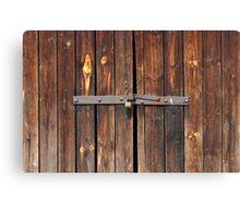 Old Wooden door locked with rusty padlock Canvas Print