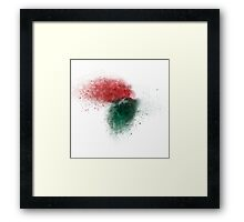 exploding red and green wooden building blocks Framed Print
