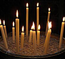 Candles in Basilica di Santa Maria in Trastevere by kirilart