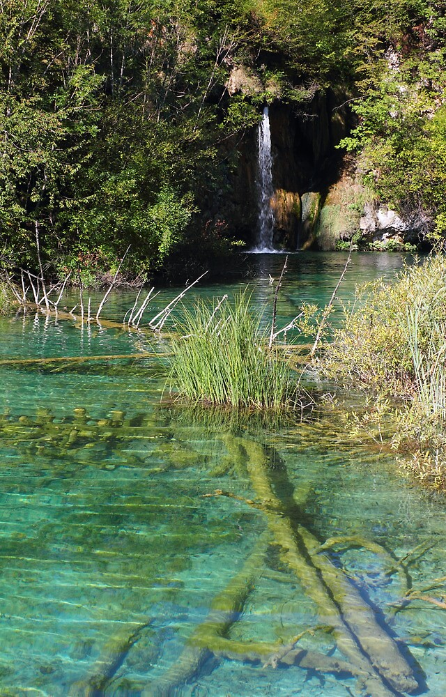 Small waterfall and an emerald colored lake by kirilart