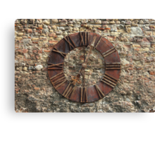 Ancient Clock Face on wall Background Canvas Print