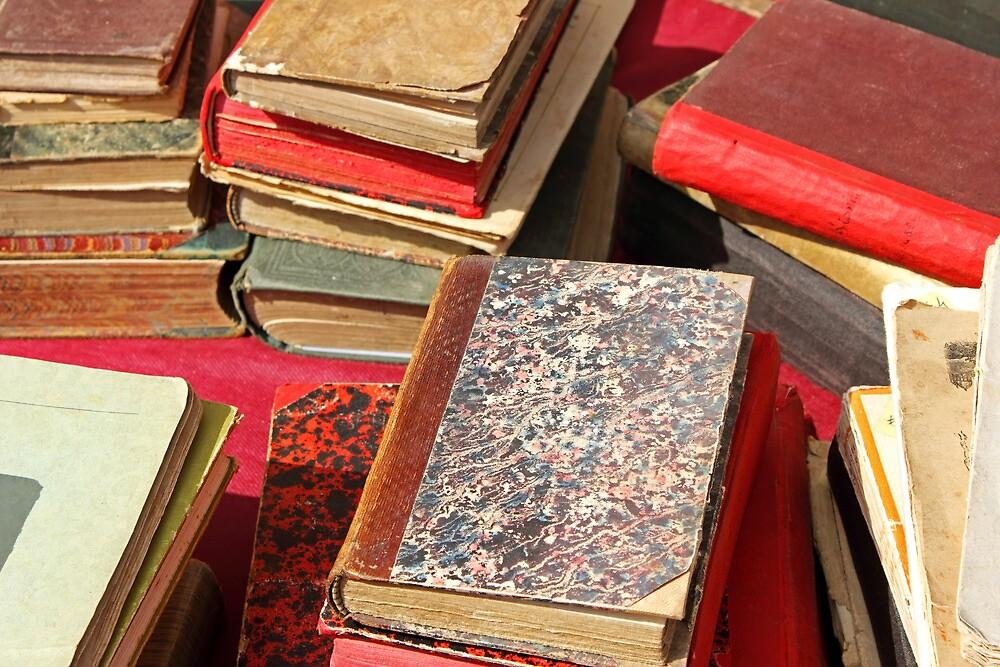 Piles of old books by kirilart