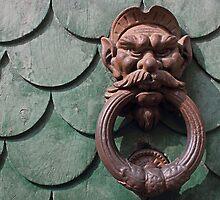 Vintage rusty door knocker in Pisa Italy by kirilart