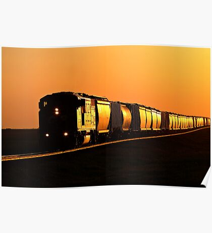 Setting sun reflecting off train and track Poster