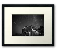 Star tracks over old abandoned garage in Saskatchewan Framed Print