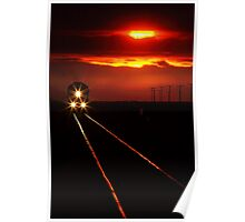 Scenic view of an approaching trrain near sunset Poster