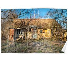 Ruined and damaged old house photo Poster