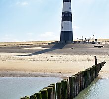 Lighthouse on a beach in Holland by 7horses